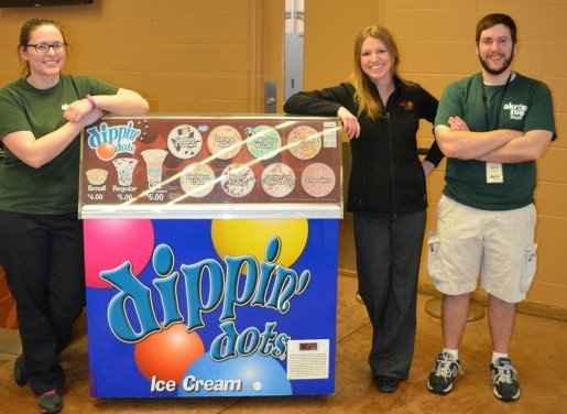 Niki Hosafros, assistant food operations supervisor, Kevin Freiman, food service attendant and Jena Strzalkowski, food operations manager, of the Akron Zoo, photographed with a Dippin' Dots cart. This summer, the zoo will feature carts that will be moved throughout the attraction to bring snacks to wherever the crowds are.