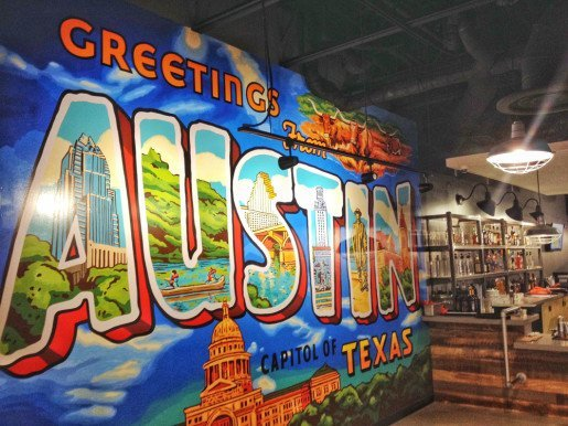 A Greetings from Austin decoration at High 5. Special paint  work and lighting draws guests in at the facility.