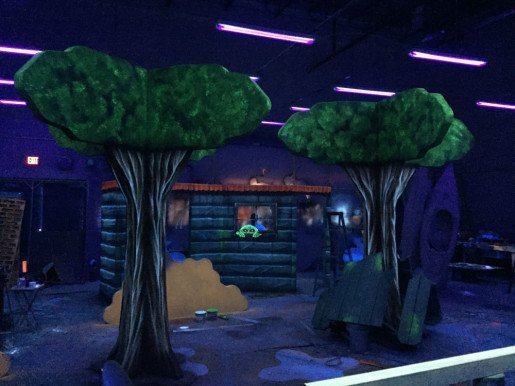 Tree props from Studio 41b. Aside from creating art in the dark, the company's owner said the biggest challenge of designing an effective space like the Haunted Forest laser tag arena at Spare Time is the balance between visual aesthetics and the logistics of play.
