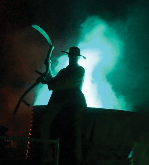 An actor at Dead North. The Butcher Brothers Slaughterhouse is a popular stop along the attraction's haunted trail.