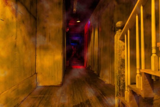 """A hallway at Haunted Acres. """"People like to be more entertained than grossed out, and it's more family-oriented,"""" the co-owner said."""