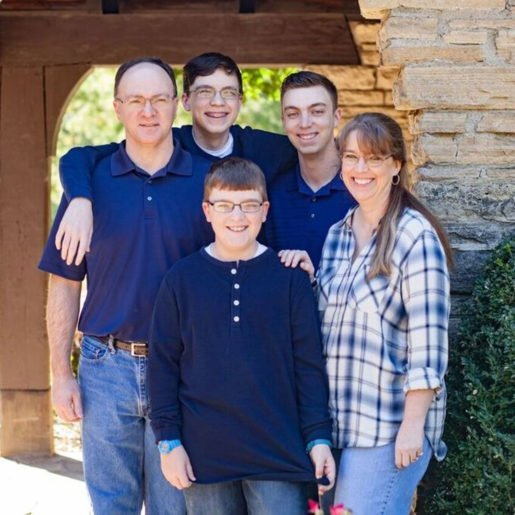 Kristy Morse, co-owner and president of Purple Pin Marketing, Inc., dba Warrior Lanes in Waukee, Iowa with her family. Pictured here with Kristy are husband Brad Basart-Morse, and sons Jack Basart-Morse, Adam Morse and Zachary Basart-Morse. Photo credit Valerie Carr, owner of Urban Photographic Arts.