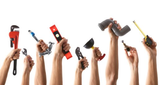 Set of male hands holding plumbing equipment on white background