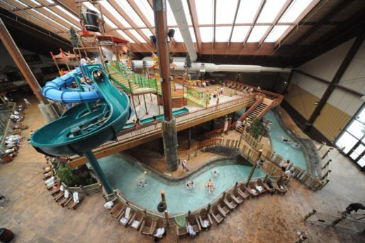 A view of the indoor waterpark at Six Flags Great Escape Lodge & Indoor Water Park. The waterpark now features ambient lighting that illuminates the Adirondack-themed center as dusk settles each night.