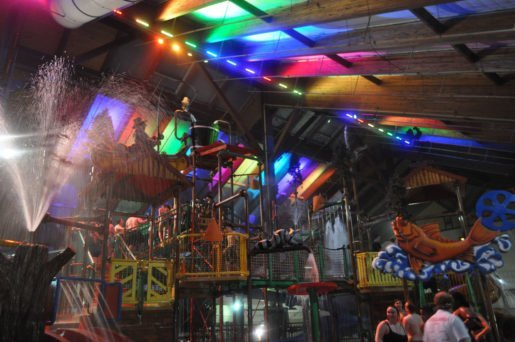 During Splashtacular! at Six Flags Great Escape Lodge & Indoor Water Park, White Water Bay in Queensbury, N.Y., guests are drenched in color as hundreds of moving lights and special effects set to music light up the indoor waterpark.