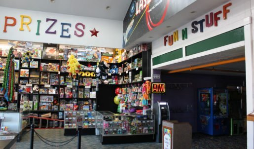 A prize counter and the arcade area at Fun 'N' Stuff. Keeping the prizes appealing, new, and different helps the arcade bring back local residents and prevent them from becoming bored, the general manager said.