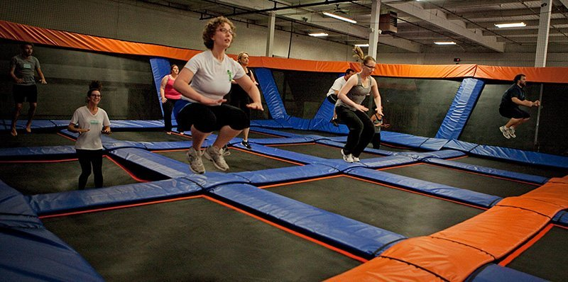 Jumpers participating in a SkyFit class, which is a cross-fit style workout on trampolines, at SkyMania Trampolines in Kirkland, Wash. Each issue of TAP offers coverage of the growing trampoline park industry.