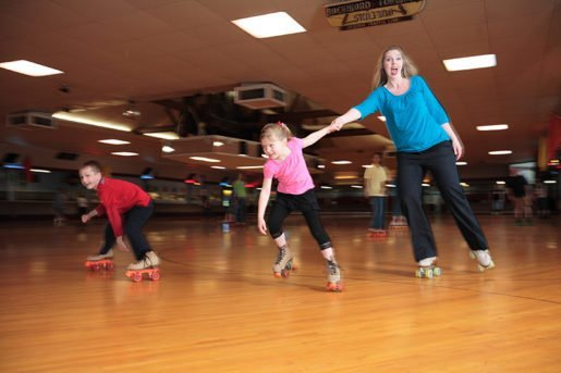 Oaks Park Association Promotion and Events Manager Emily MacKay skates with her daughter. The center is featured in the April/May issue of TAP.