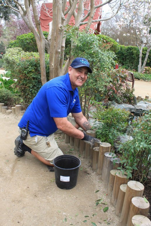 Fairytale Town Grounds Manager George Ortiz at work in this storybook park . A look at how the attraction keeps its facility looking great appears in an article in the April/May issue of TAP.